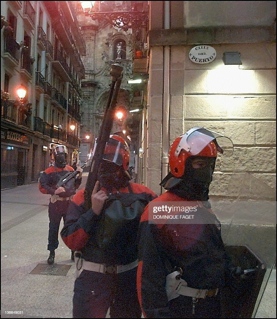 Basque policemen patrol a street of the San Sebastian 'parte vieja' 15 July one day after the funeral of Miguel Angel Blanco who was assassinated by...