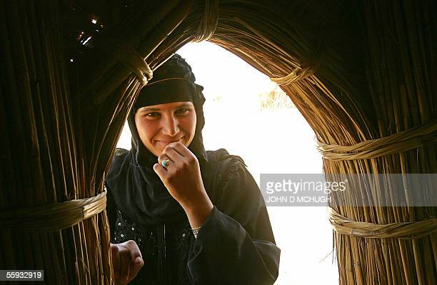 A Marsh Arab poses in Abu al Muhammen just outside Basra in southern Iraq 16 October 2005 as millions of ballots are being counted all over the...