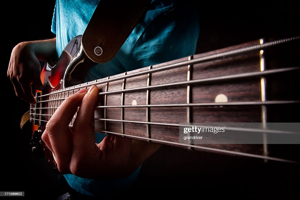 bass guitar player stock photo getty images. Black Bedroom Furniture Sets. Home Design Ideas