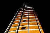 Four string bass guitar neck with black background