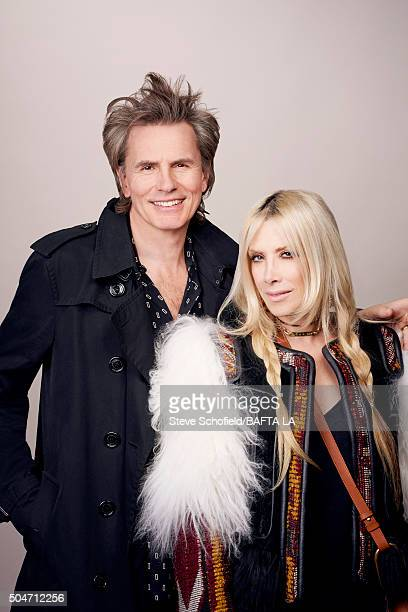 Bass guitarist and cofounder of new wave band Duran Duran John Taylor and Gela Nash pose for a portrait at the BAFTA Los Angeles Awards Season Tea at...