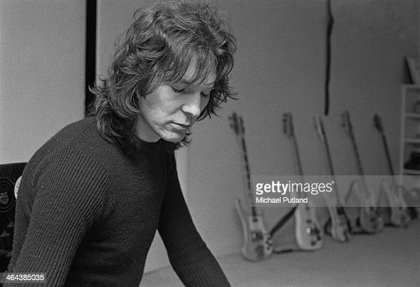 Bass guitarist Chris Squire of English progressive rock group Yes 10th January 1974 Behind him are five electric bass guitars