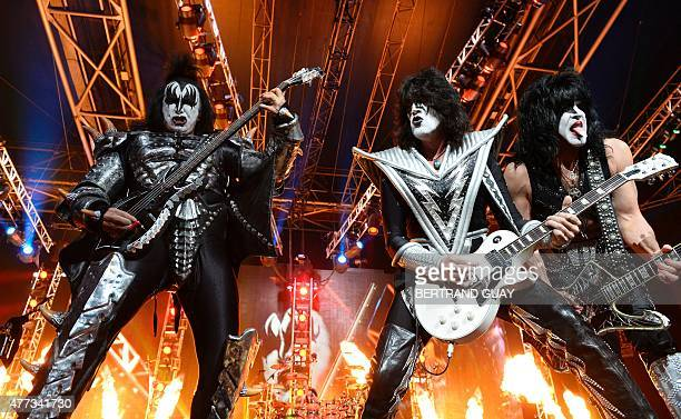 Bass guitarist Gene Simmons guitarist Tommy Thayer and singer and guitarist Paul Stanley of US rock band Kiss perform on stage at the Zenith in Paris...