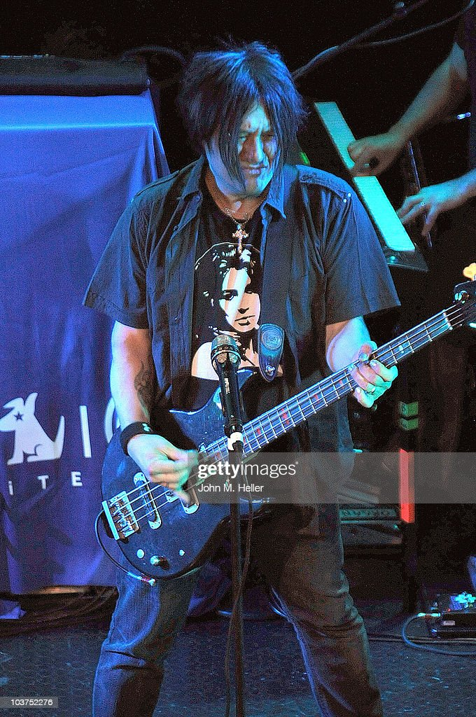 Bass Guitarist of the Goo Goo Dolls <a gi-track='captionPersonalityLinkClicked' href=/galleries/search?phrase=Robby+Takac&family=editorial&specificpeople=778886 ng-click='$event.stopPropagation()'>Robby Takac</a> performs as part of SIRIUS XM's Coffe House Live series at the Troubadour on August 31, 2010 in Los Angeles, California.