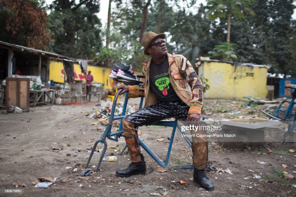 Bass player Cavalier of Staff Benda Bilili is photographed for Paris Match on August 27, 2013 in Kinshasa, Democratic Republic of Congo.
