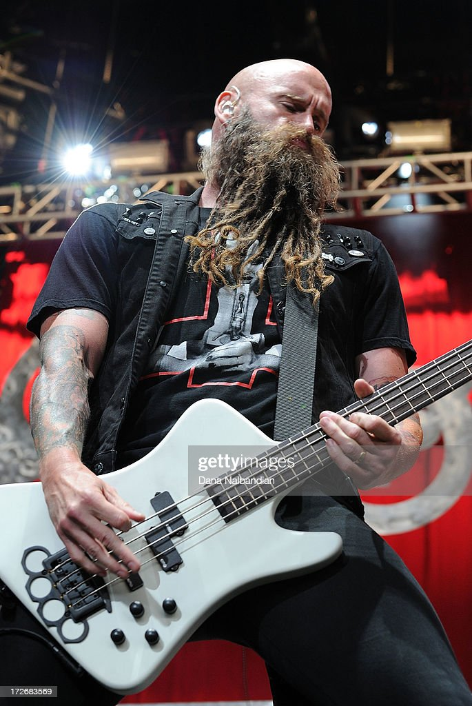 Bass player Chris Kael of Five Finger Death Punch performs at White River Amphitheater on July 3, 2013 in Auburn, Washington.