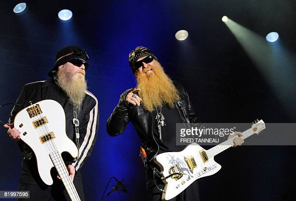 US bass player Dusty Hill and guitar player Billy Gibons of the texan rockblues band ZZ TOP perform on stage on July 18 2008 in CarhaixPlouguer...