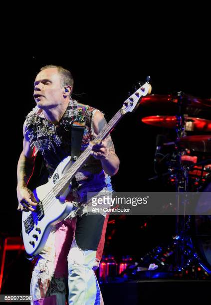 US bass player Flea of rock band Red Hot Chili Peppers performs at the Palacio de los Deportes in Mexico City on October 10 2017 The Red Hot is in...
