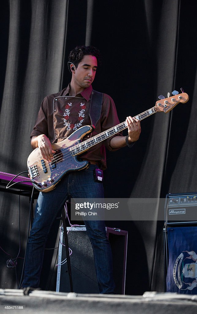 Bass player Miguel Briseo of Lord Huron performs at the Squamish Valley Music Festival on August 10, 2014 in Squamish, Canada.