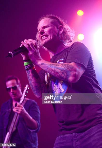 Bass player Robert DeLeo of Stone Temple Pilots and singer Corey Taylor of Stone Sour and Slipknot perform onstage during the second annual Rock for...