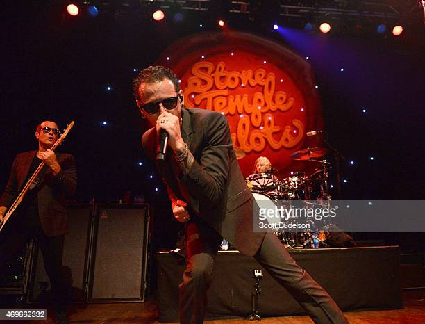 Bass player Robert DeLeo singer Chester Bennington and drummer Eric Kretz of Stone Temple Pilots perform onstage at House of Blues Sunset Strip on...