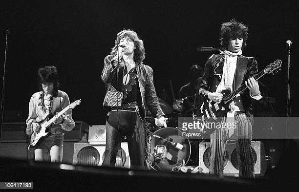 Bass player Ronnie Wood singer Mick Jagger and guitarist Keith Richards of British rock group the Rolling Stones perform on stage in June 1976