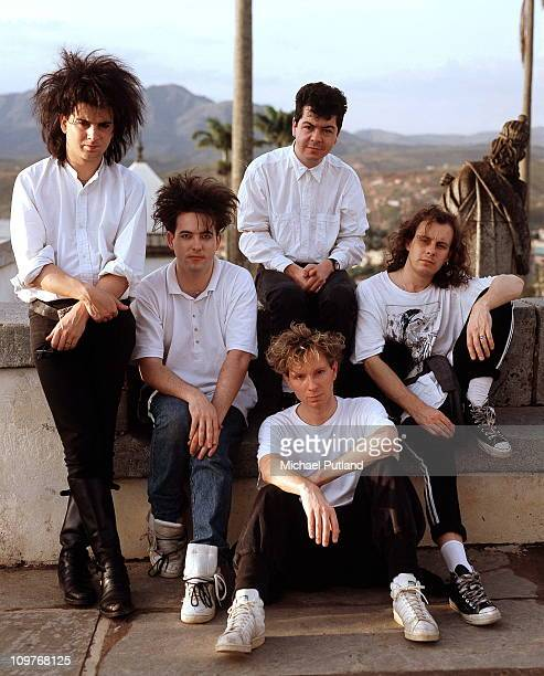 Bass player Simon Gallup singer Robert Smith drummer Boris Williams keyboard player Laurence 'Lol' Tolhurst and guitarist Porl Thompson of British...