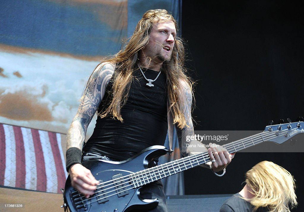Bass player Ted Lundstrom of Amon Amarth performs at White River Amphitheater on July 3, 2013 in Auburn, Washington.