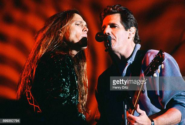 Bass player Timothy B Schmit and guitarist Glenn Frey play with The Eagles on their 'Hell Freezes Over' tour of 1995 The Eagles were the most popular...