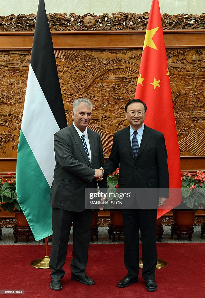 Bassam al-Salhi (L), the general secretary of the Palestinian People's Party, shakes hands with Chinese Foreign Minister Yang Jiechi (R) during their meeting at the Foreign Ministry building in Beijing on November 23, 2012. The Palestinian member of parliament is visiting China to discuss the violence in Gaza AFP PHOTO/Mark RALSTON