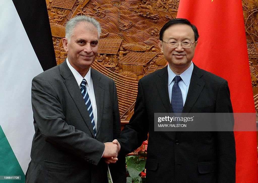 Bassam al-Salhi (L), the general secretary of the Palestinian People's Party, shakes hands with Chinese Foreign Minister Yang Jiechi (R) at the Foreign Ministry building in Beijing on November 23, 2012. The Palestinian member of parliament is visiting China to discuss the violence in Gaza. AFP PHOTO / Mark RALSTON