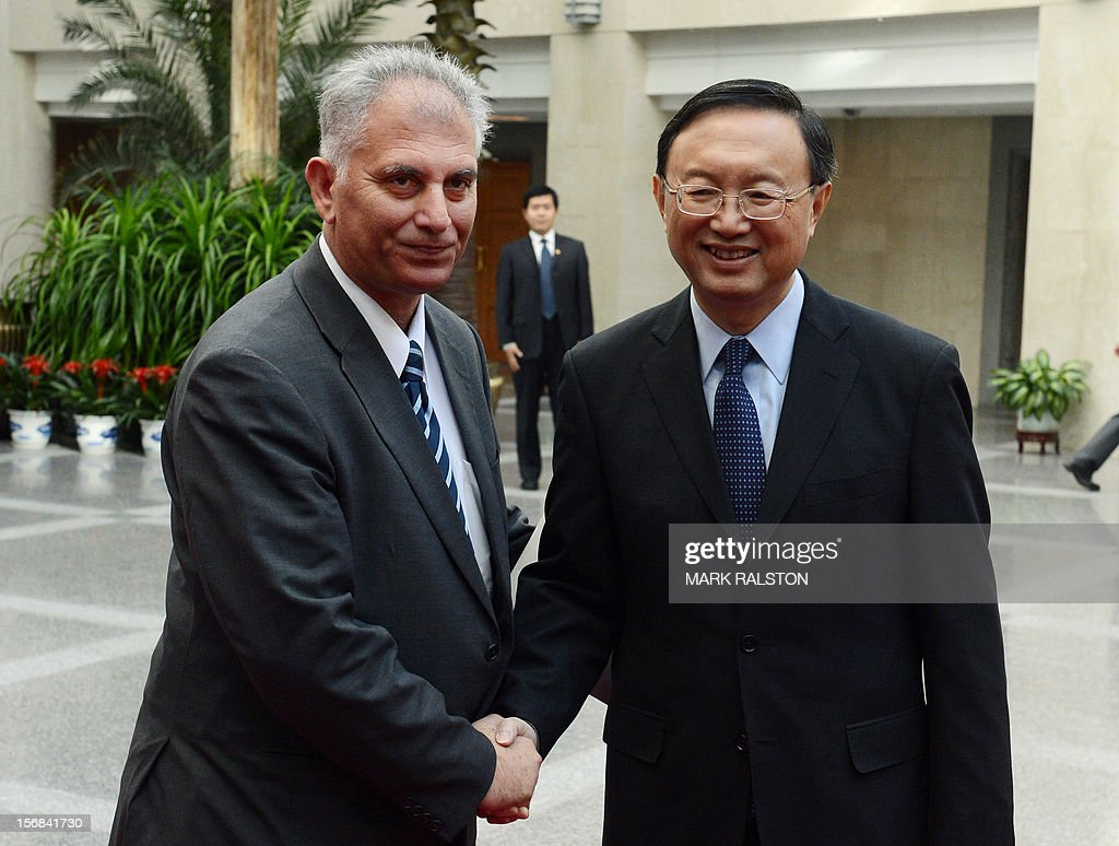 Bassam al-Salhi (L), the general secretary of the Palestinian People's Party, shakes hands with Chinese Foreign Minister Yang Jiechi (R) during their meeting at the Foreign Ministry building in Beijing on November 23, 2012. The Palestinian member of parliament is visiting China to discuss the violence in Gaza. AFP PHOTO/Mark RALSTON