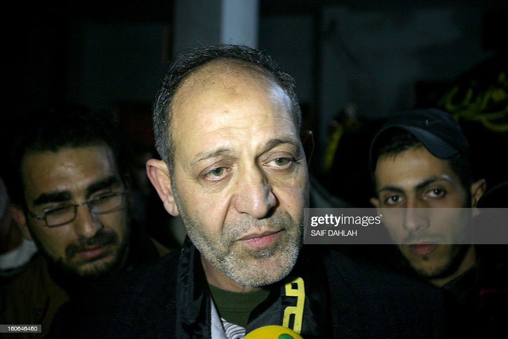 Bassam Saadi, leader of the West Bank Islamic Jihad movement answers to journalists' questions as he heads back home at the Jenin refugee camp in the West Bank after being held for 2 years in an Israeli jail, on February 4, 2013.