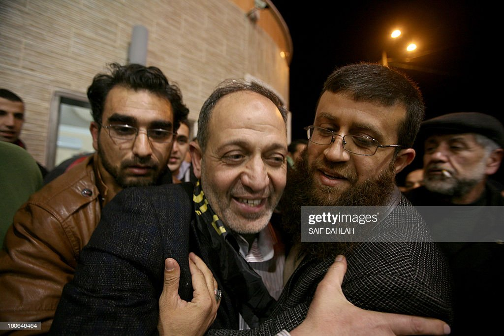 Bassam Saadi, leader of the West Bank Islamic Jihad movement is congratulated as he heads back home at the Jenin refugee camp in the West Bank after being held for 2 years in an Israeli jail, on February 4, 2013. AFP PHOTO/SAIF DAHLAH