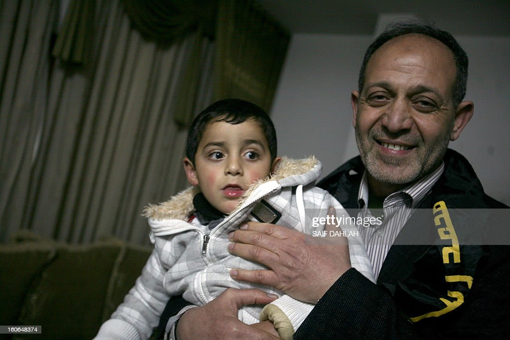 Bassam Saadi, leader of the West Bank Islamic Jihad movement poses with the son of a Palestinian prisoner during a visit in the West Bank village of Arraba near Jenin in the West Bank on February 4, 2013. Saadi was released after being held for 2 years in an Israeli jail.