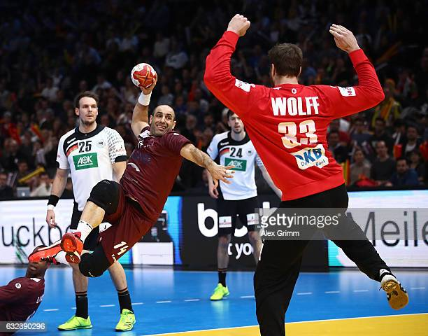 Bassel Alrayes of Qatar throws a goal past Andreas Wolff of Germany during the 25th IHF Men's World Championship 2017 Round of 16 match between...
