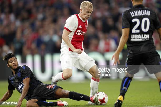 Bassem Srarfi of OCG Nice Donny van de Beek of Ajax Maxime Le Marchand of OCG Nice during the UEFA Champions League third round qualifying first leg...