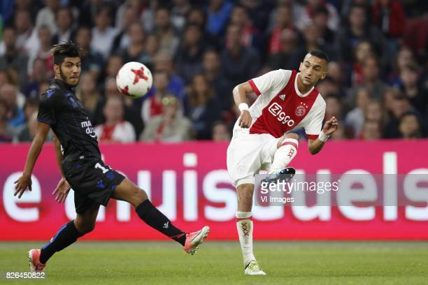 Bassem Srarfi of OCG Nice Hakim Ziyech of Ajax during the UEFA Champions League third round qualifying first leg match between Ajax Amsterdam and OGC...