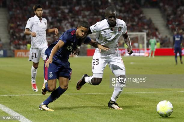 Bassem Srarfi of OCG Nice Justin Kluivert of Ajax Malang Sarr of OCG Nice during the UEFA Champions League third round qualifying first leg match...