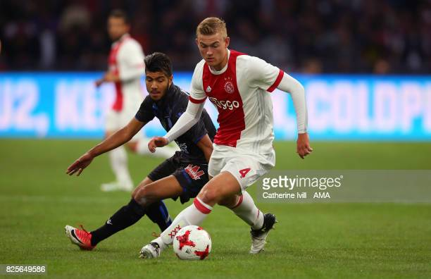 Bassem Srarfi of OGC Nice and Matthijs Ligt of Ajax during the UEFA Champions League Qualifying Third Round match between Ajax and OSC Nice at...