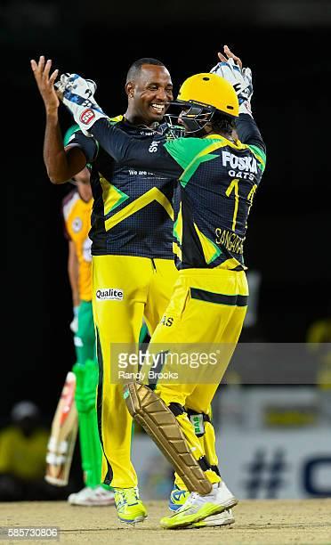 Basseterre Saint Kitts and Nevis 3 August 2016 Garey Mathurin and Kumar Sangakkara of Jamaica Tallawahs celebrate the dismissal of Jason Mohammed of...