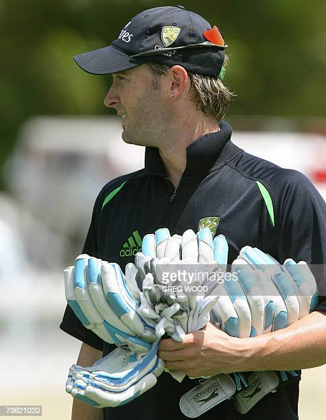 Basseterre St Kitts SAINT KITTS AND NEVIS Australian cricketer Michael Clarke carries his used batting gloves following a training session on the...