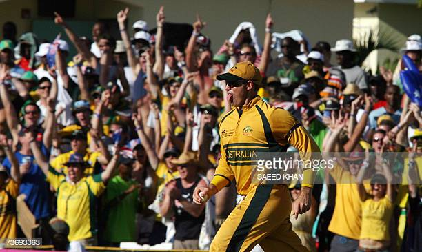 Basseterre St Kitts SAINT KITTS AND NEVIS Australian cricketer Matthew Hayden celebrates his catch of South African batsman Ashwell Prince off pacer...