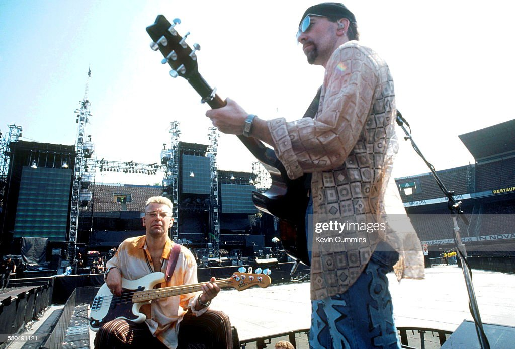 Bassist Adam Clayton and guitarist The Edge of Irish rock group U2 at a soundcheck USA circa 1992