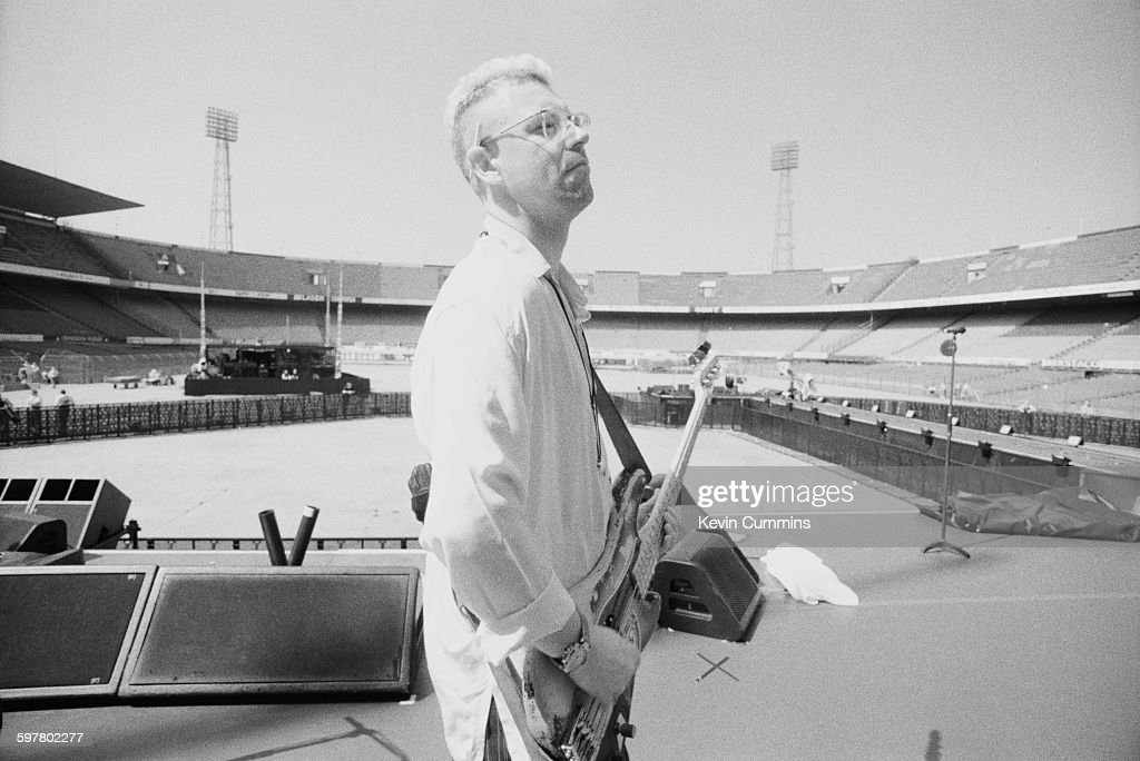 Bassist Adam Clayton of Irish rock group U2 at a soundcheck at Feijenoord Stadion Rotterdam during the band's Zoo TV tour 11th May 1993