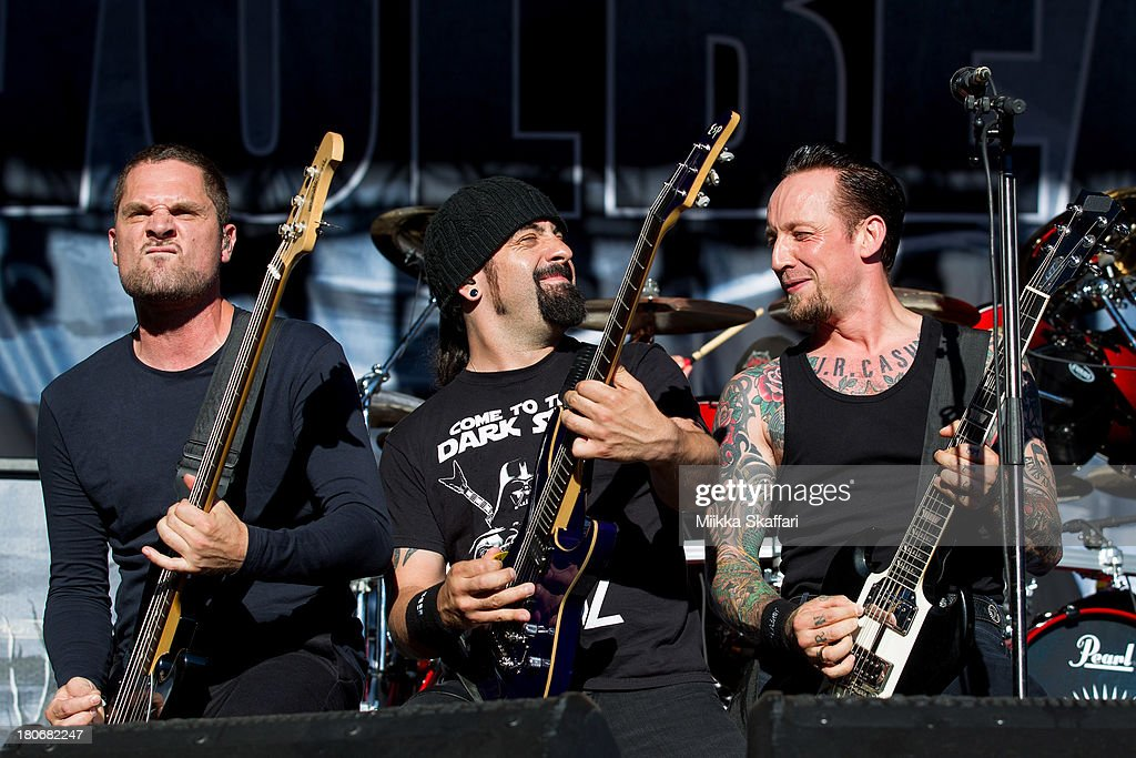 Bassist Anders Kj¿lholm guitarist Rob Caggiano and vocalist Michael Poulsen of Volbeat perform in Monster Energy's Aftershock Festival at Discovery...