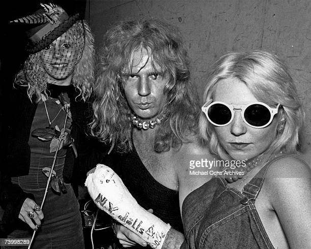 Bassist Arthur Kane of the glam rock band New York Dolls poses for a portrait with young groupies including Sable Starr in circa 1973 in Los Angeles...