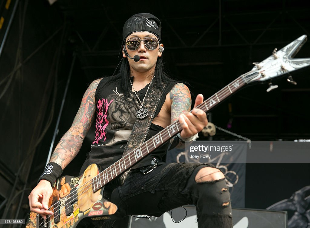 Bassist Ash Purdy of Black Veil Brides performs onstage during the Vans Warped Tour 2013 at Klipsch Music Center on July 3, 2013 in Noblesville, Indiana.