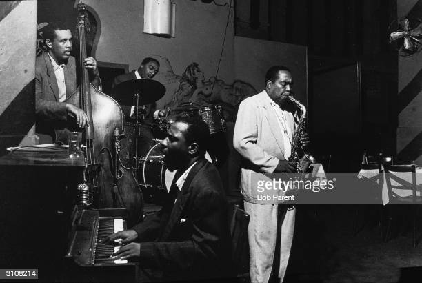 Bassist Charles Mingus drummer Roy Haynes pianist Thelonious Monk and saxophonist Charlie Parker perform at the Open Door New York New York September...