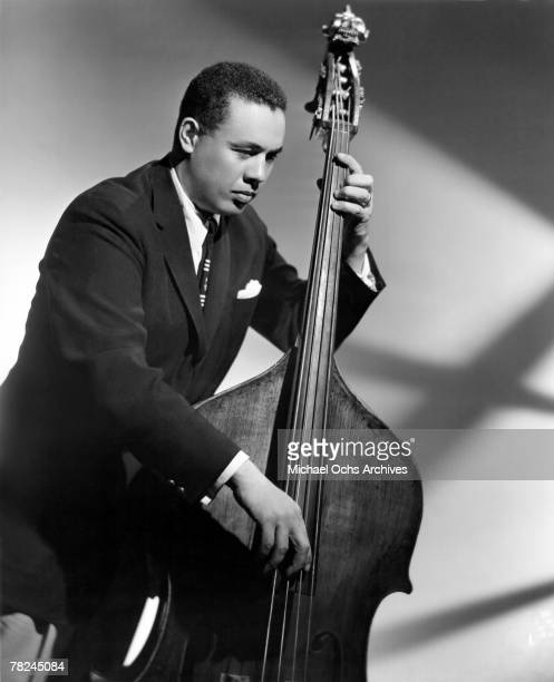 Bassist Charlie Mingus poses for a studio portrait circa 1946 in New York City New York