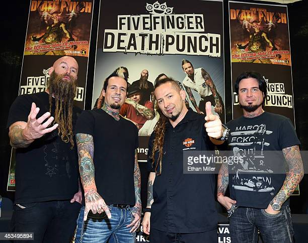 Bassist Chris Kael drummer Jeremy Spencer and guitarists Zoltan Bathory and Jason Hook of Five Finger Death Punch appear at Nellis Air Force Base as...