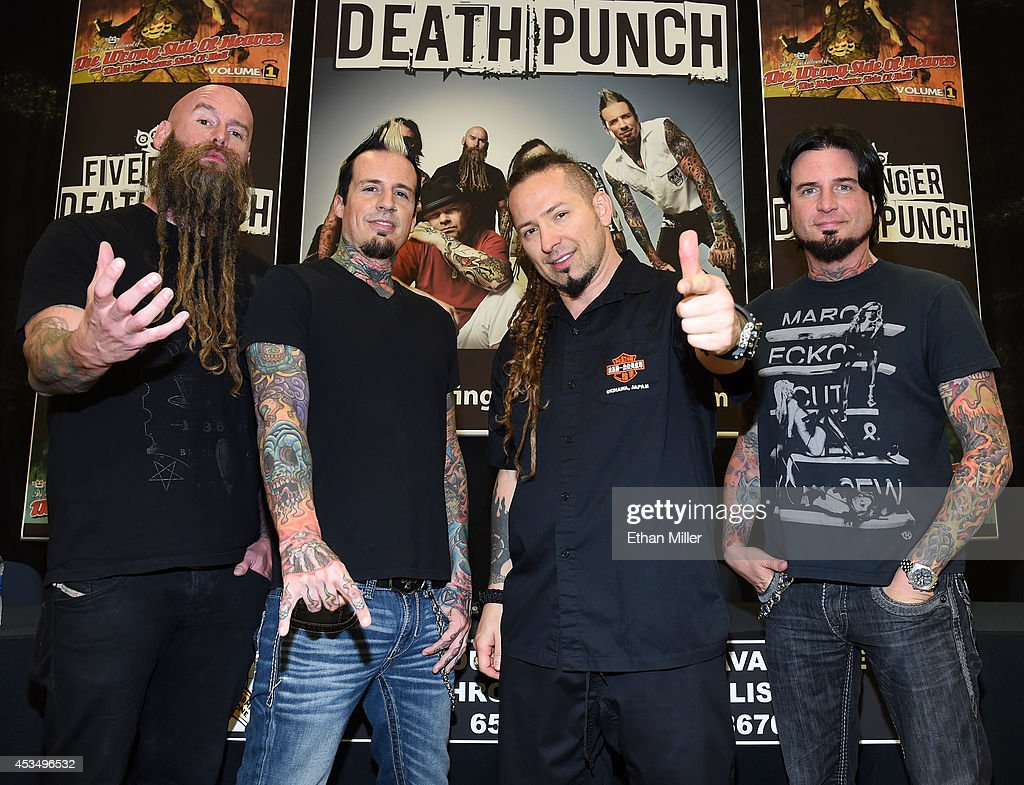 Bassist Chris Kael, drummer Jeremy Spencer, and guitarists Zoltan Bathory and Jason Hook of Five Finger Death Punch appear at Nellis Air Force Base as the band highlights its campaign to raise awareness about veterans suffering from post-traumatic stress disorder (PTSD), in part by launching the video 'Wrong Side of Heaven,' that deals with the subject on August 11, 2014 in Las Vegas, Nevada.