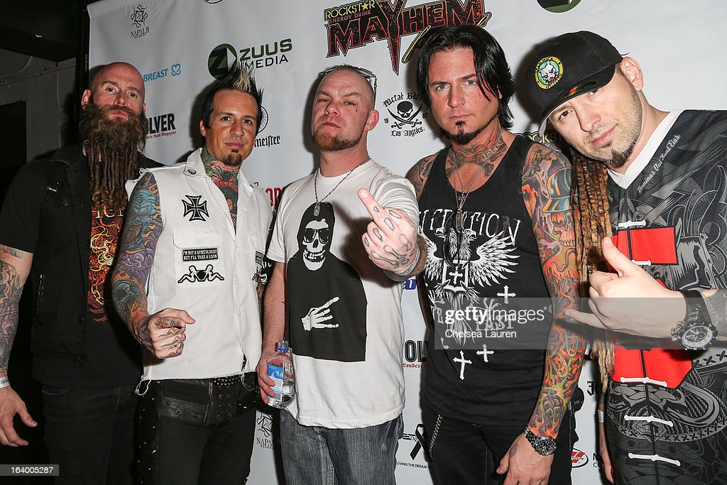 Bassist Chris Kael, drummer Jeremy Spencer, vocalist Ivan Moody, guitarist Jason Hook and guitarist Zoltan Bathory of Five Finger Death Punch attend the 6th annual Rockstar energy drink Mayhem festival press conference at The Whiskey A Go Go on March 18, 2013 in West Hollywood, California.