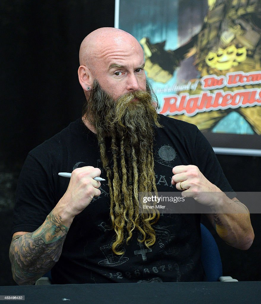Bassist Chris Kael of Five Finger Death Punch appears at Nellis Air Force Base as the band highlights its campaign to raise awareness about veterans suffering from post-traumatic stress disorder (PTSD), in part by launching the video 'Wrong Side of Heaven,' that deals with the subject on August 11, 2014 in Las Vegas, Nevada.