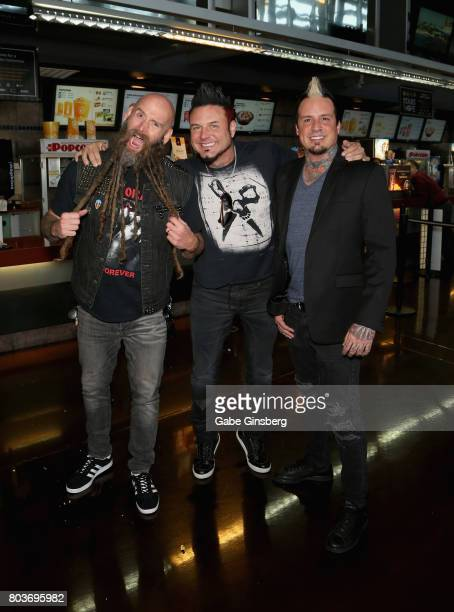Bassist Chris Kael of Five Finger Death Punch coproducer of 'Hired Gun Out of the Shadows into the Spotlight' guitarist Jason Hook of Five Finger...
