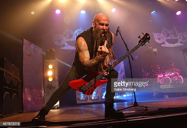 Bassist Chris Kael of Five Finger Death Punch performs at The Joint inside the Hard Rock Hotel Casino on October 24 2014 in Las Vegas Nevada