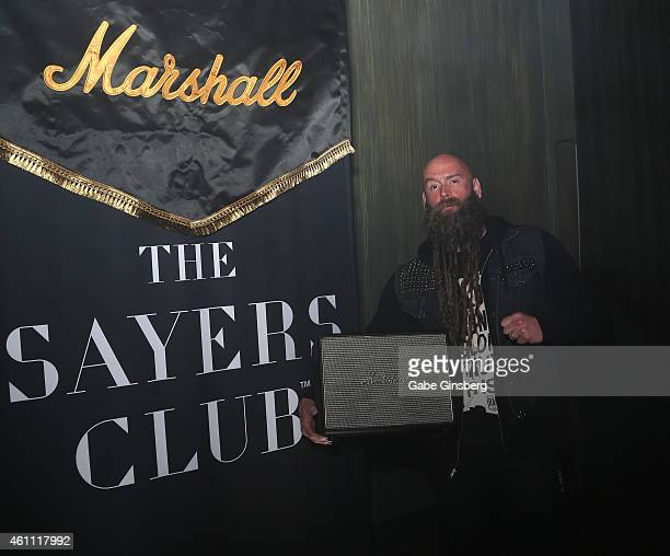 Bassist Chris Kael of Five Finger Death Punch poses with a Marshall Acton speaker during Marshall Headphones presents the Launch of Major II with...