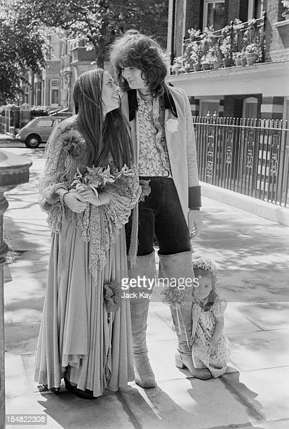 Bassist Chris Squire of progressive rock group Yes with model Nikki James at their wedding 19th June 1972 On the right is James's daughter Carmen who...