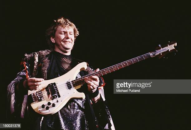 Bassist Chris Squire performing with English progressive rock group Yes 1984