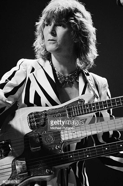 Bassist Chris Squire playing a Wal triplenecked bass guitar during a concert with English progressive rock band Yes at Madison Square Garden New York...